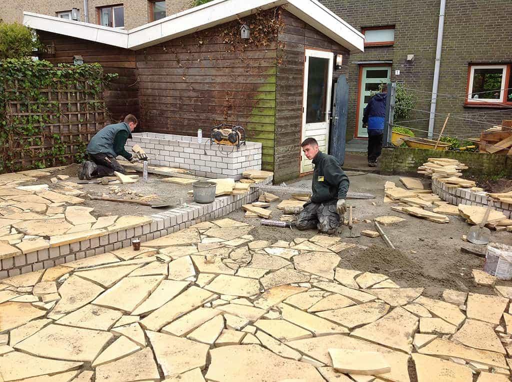 A van spelde hoveniers tuin met flagstones